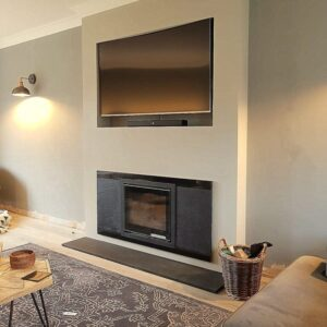 Contura i6 inset stove with combination black granite and riven slate slips and TV above