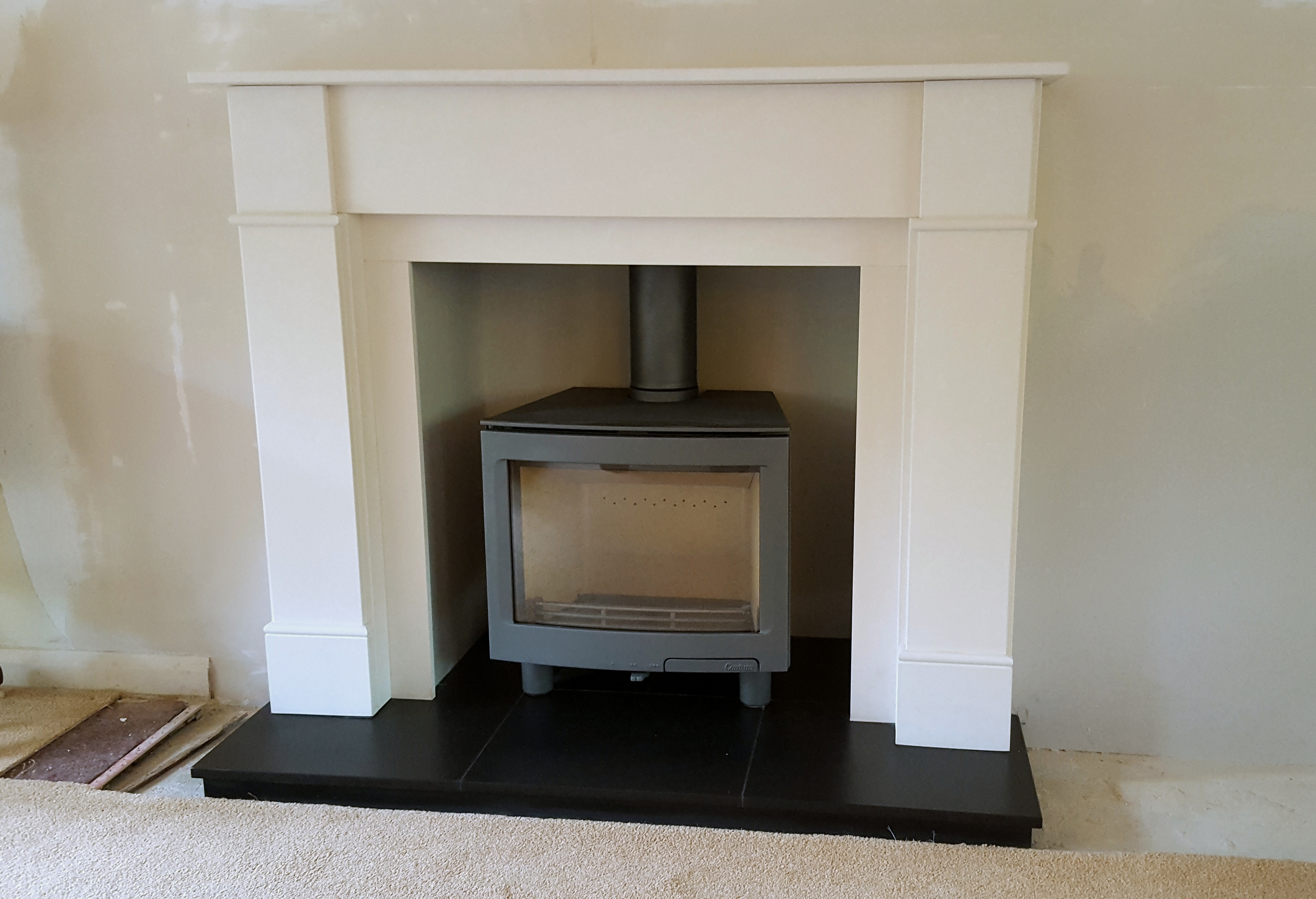 Stone fireplace installation by Bonfire Stoves