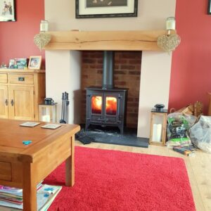 Charnwood Island 1 multifuel stove with wooden beam