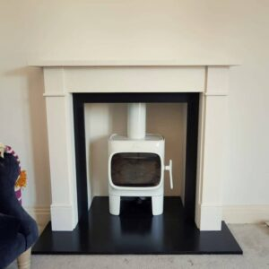 Jotul F105 Stove in white enamel and Victorian classic limestone fireplace with slate haerth