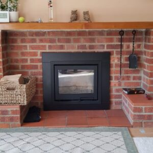 Contura i6 with slate slips installed into existing red brick fireplace
