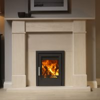 Inset woodburner in a limestone surround