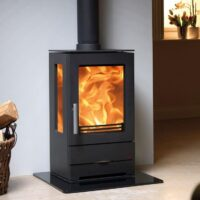 ACR Trinity three sided stove sat on glass hearth plate
