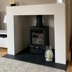Gazco Vogue gas stove with limestone surround and slate hearth