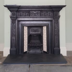Cast iron mantel and tiled insert