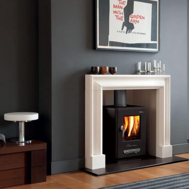 Chesneys Clandon Fireplace inset with Chesney stove in a light living room