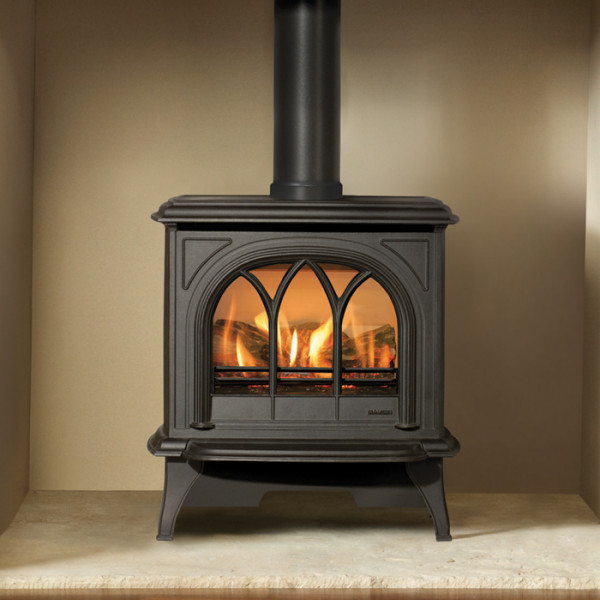 Gazco huntingdon 30 gas stove in black sitting in an open chamber