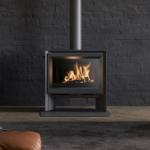 Stuv 6-H wood burning stove in black in a living room